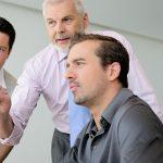 3 Männr im Meeting